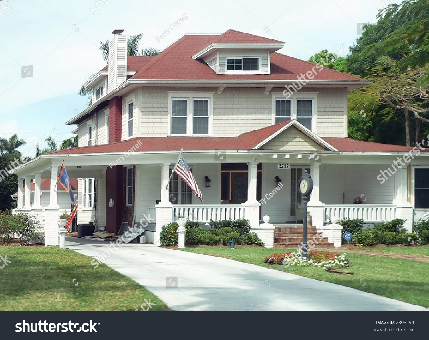 A two story traditional american home with us flag stock for Traditional american home