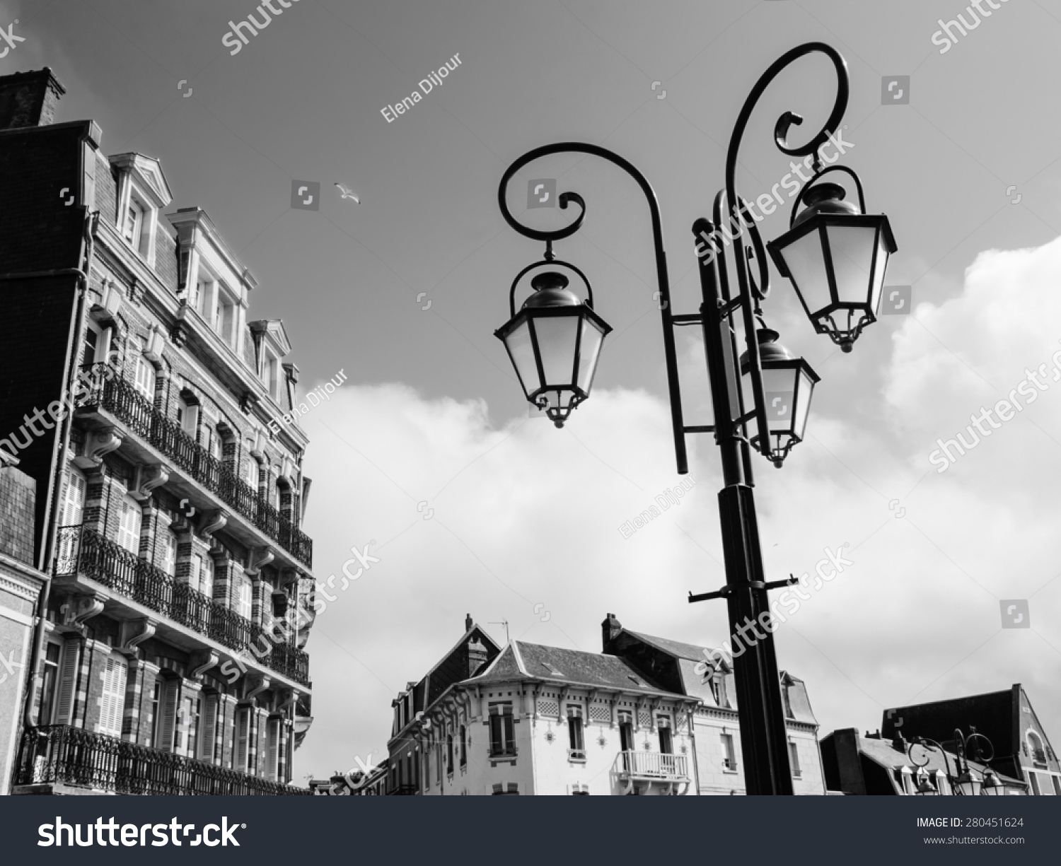 Art nouveau style buildings and streetlights in resort town mers les bains picardy france aged photo black and white stock photo