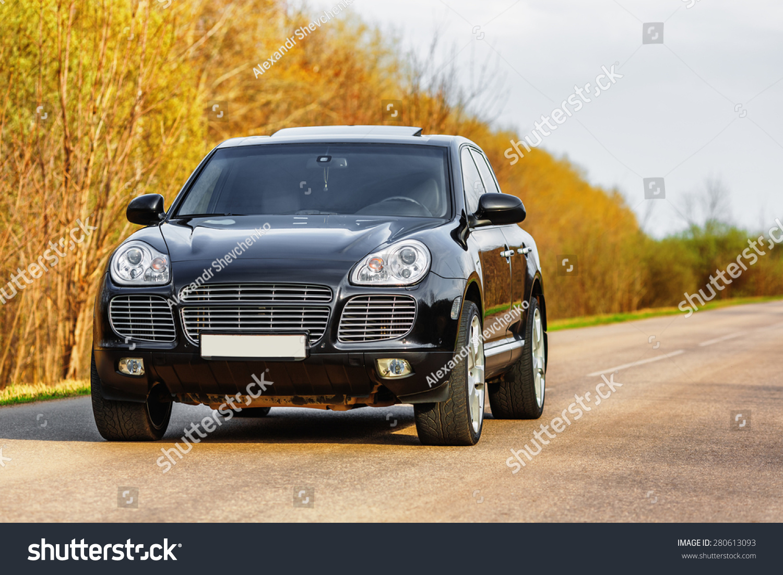 Black Luxury Vehicles: Black Luxury Car Byroad Autumn Time Stock Photo 280613093