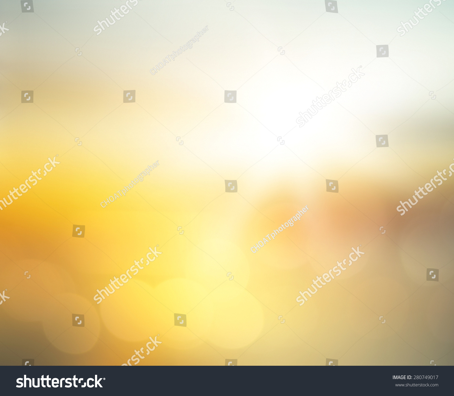 Summer holiday concept: sun light and abstract blur yellow morning sunrise beach background. #280749017