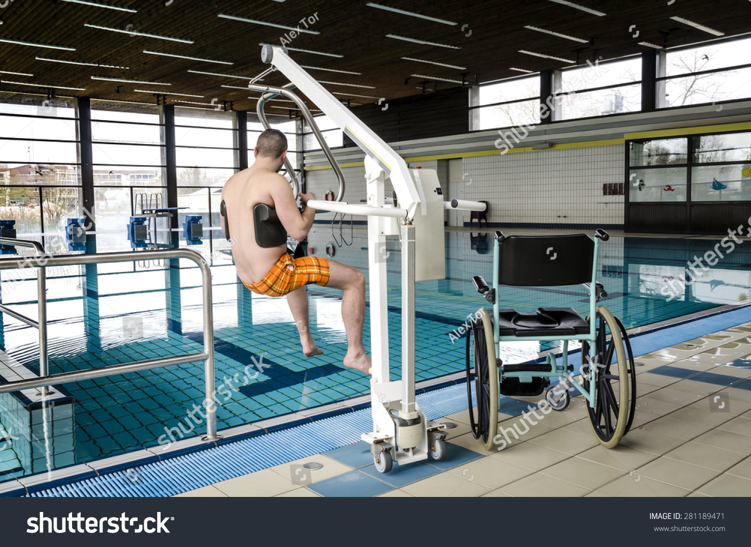 Disabled man in a swimming pool. Lift… Stock Photo 281189471 ...