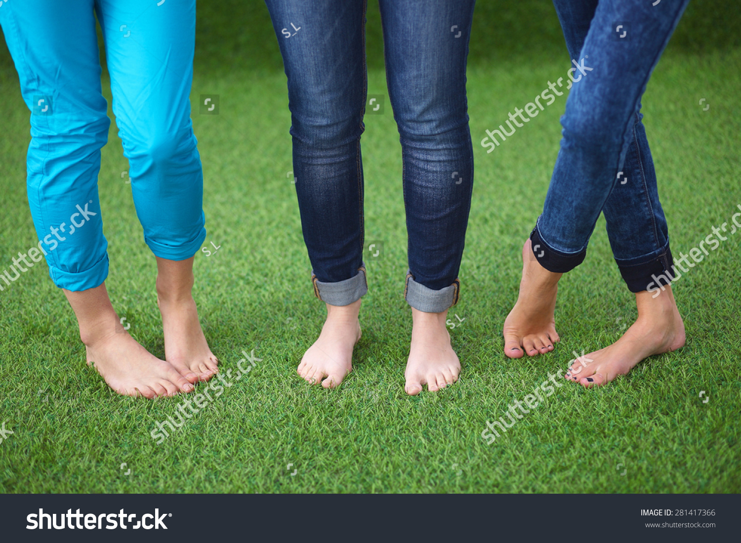 three women naked feet standing grass stock photo 281417366