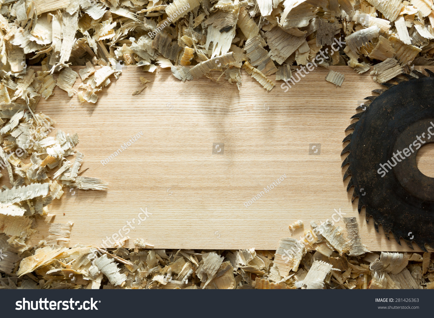 Carpenter tools on wooden table with sawdust