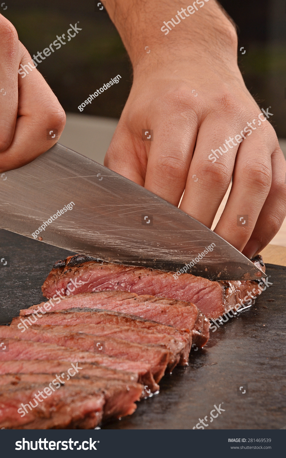 Cook slicing grilled beef steak on stock photo 281469539 shutterstock - Make lamb barbecue ...