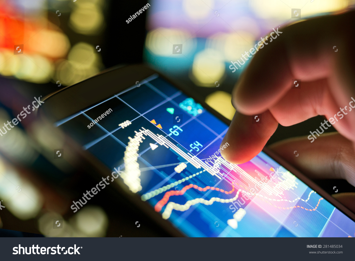 A businessman using a mobile phone to check stock market data. #281485034