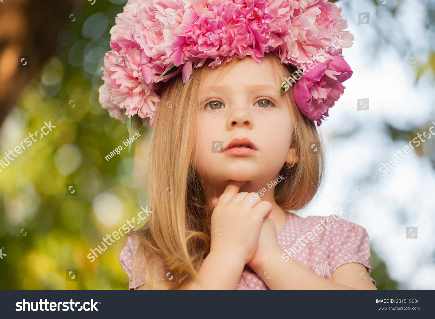 beautiful baby girl pink flowers outdoors stock photo (edit now