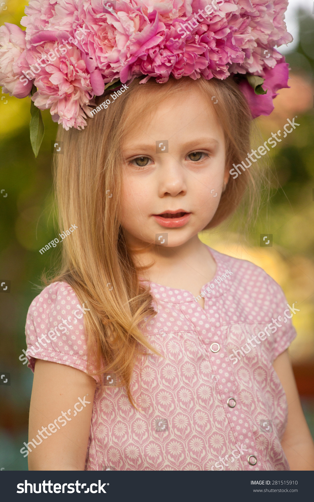 beautiful baby girl pink flowers outdoors stock photo & image