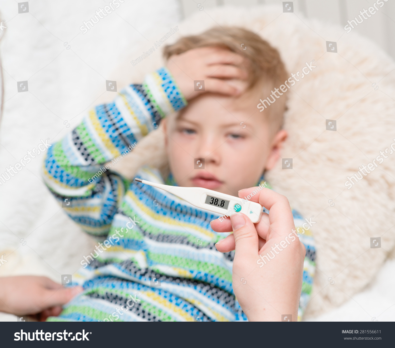 Sick kid high fever laying bed stock photo safe to use 281556611 sick kid with high fever laying in bed and mother checks the temperature altavistaventures Gallery