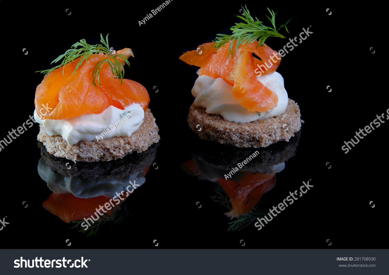 Rye canapes with cream cheese and smoked salmon a typical for Smoked salmon cream cheese canape