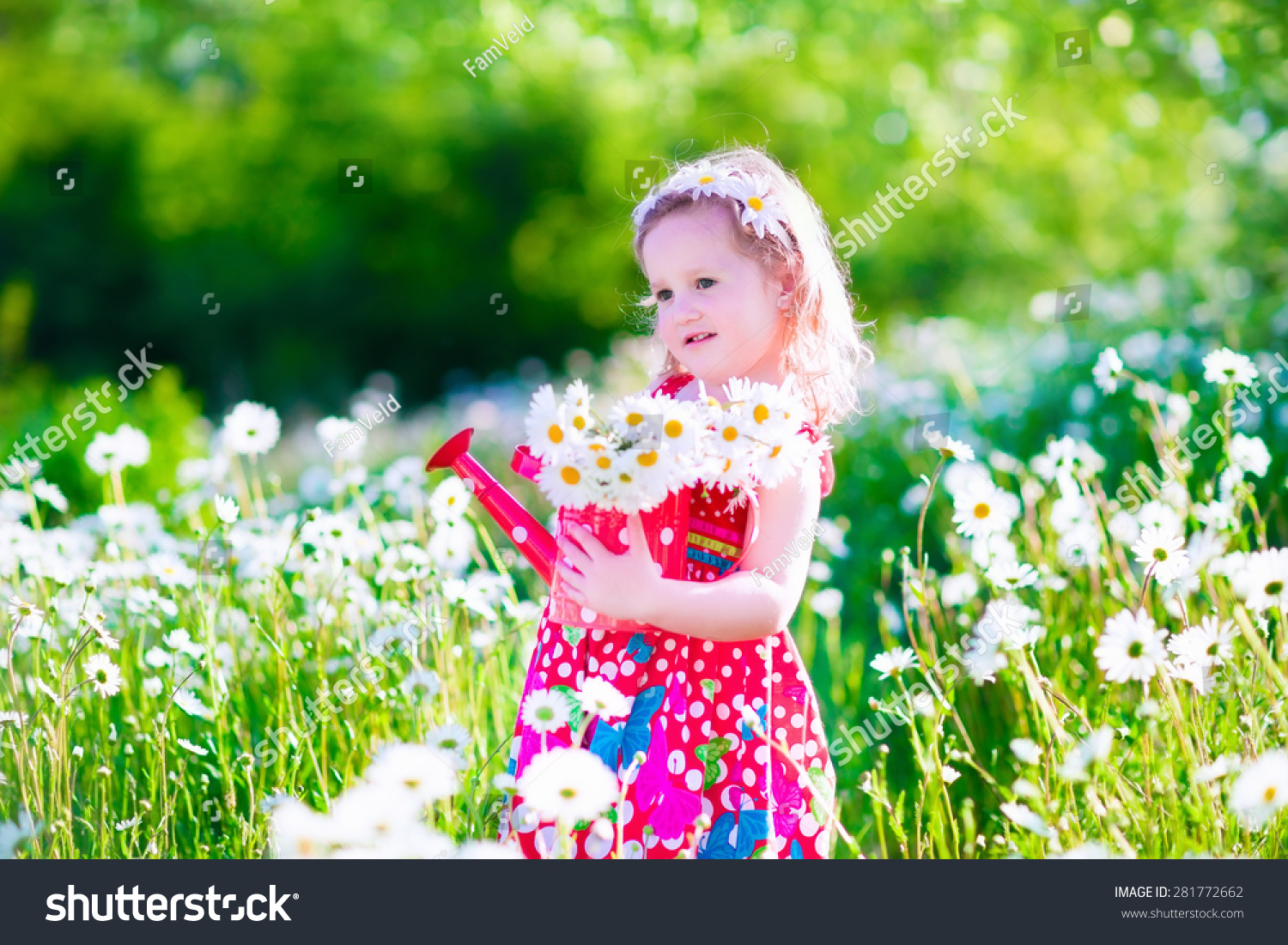 Kid Gardening Little Girl With Water Can In A Daisy