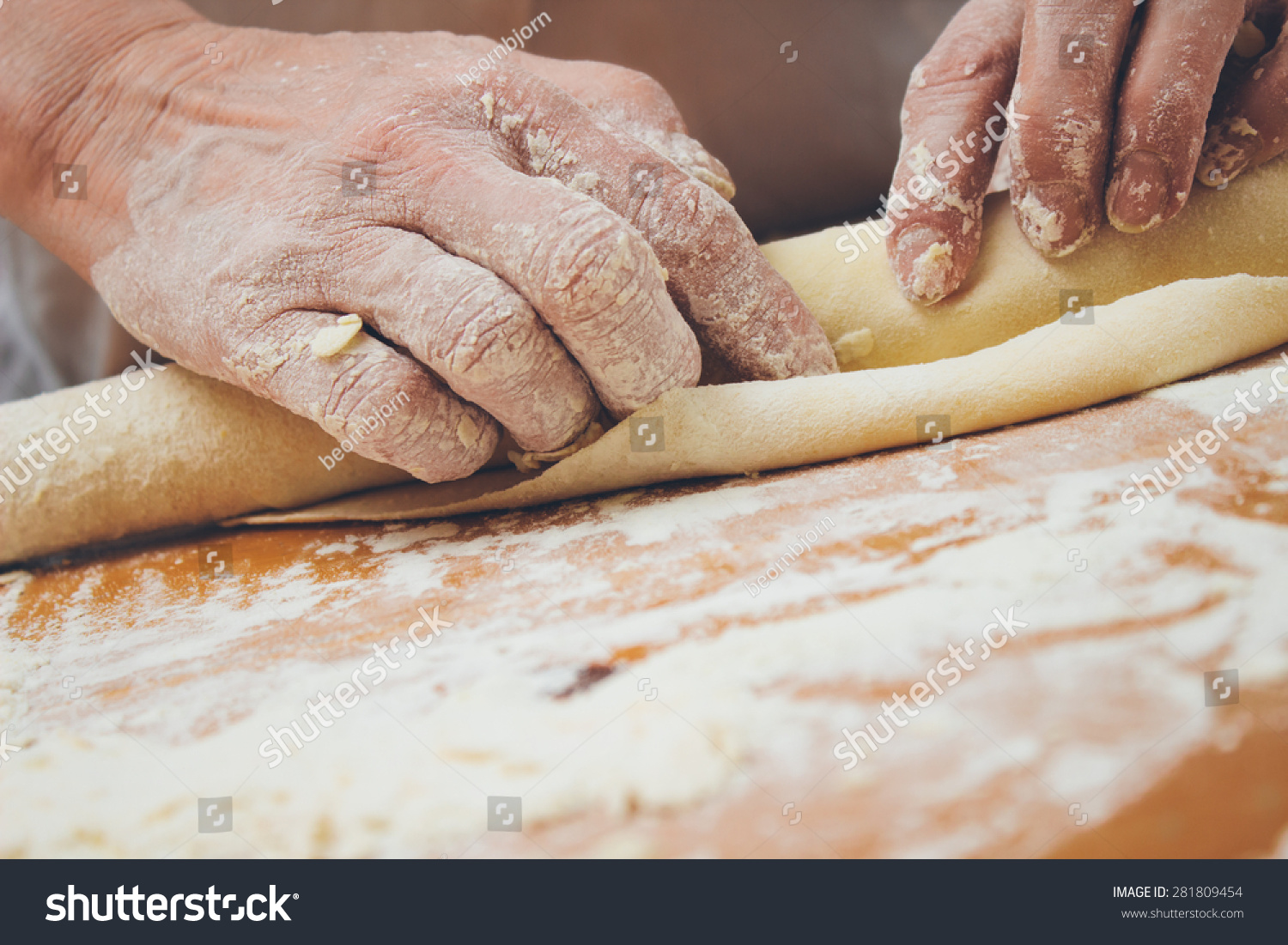 Close Up Photo Of Baker Kneading Dough With A Rolling Pin. Retro Styled Imagery. Grain Added ...