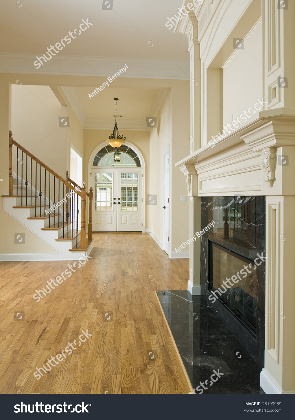 Luxury home foyer door staircase and fireplace stock photo ...