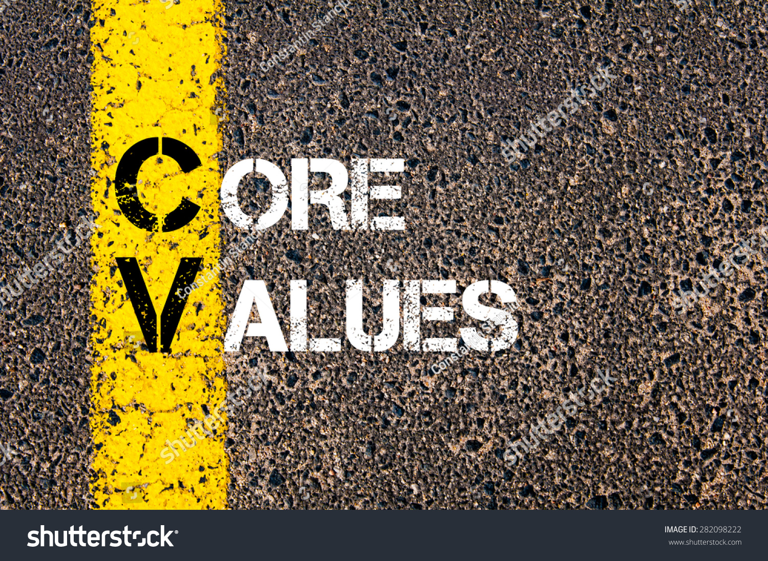 concept image of business acronym cv as core values written over road marking yellow paint line