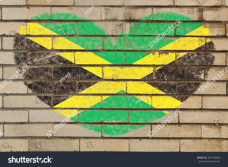 Jamaica Flag on a brick wall background | EZ Canvas