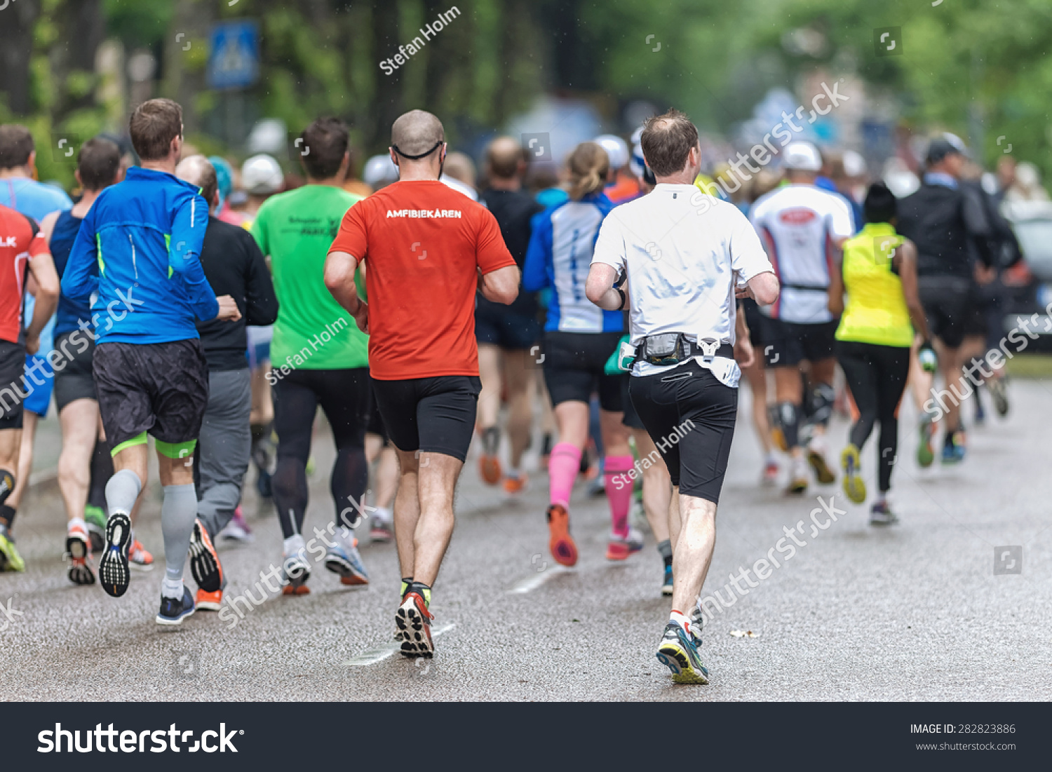 STOCKHOLM MAY 30 Back of a group of people at the streets of Stockholm at ASICS Stockholm Marathon 2015 May 30 2015 in Stockholm Sweden Runners from 101 nations were registered in 2015