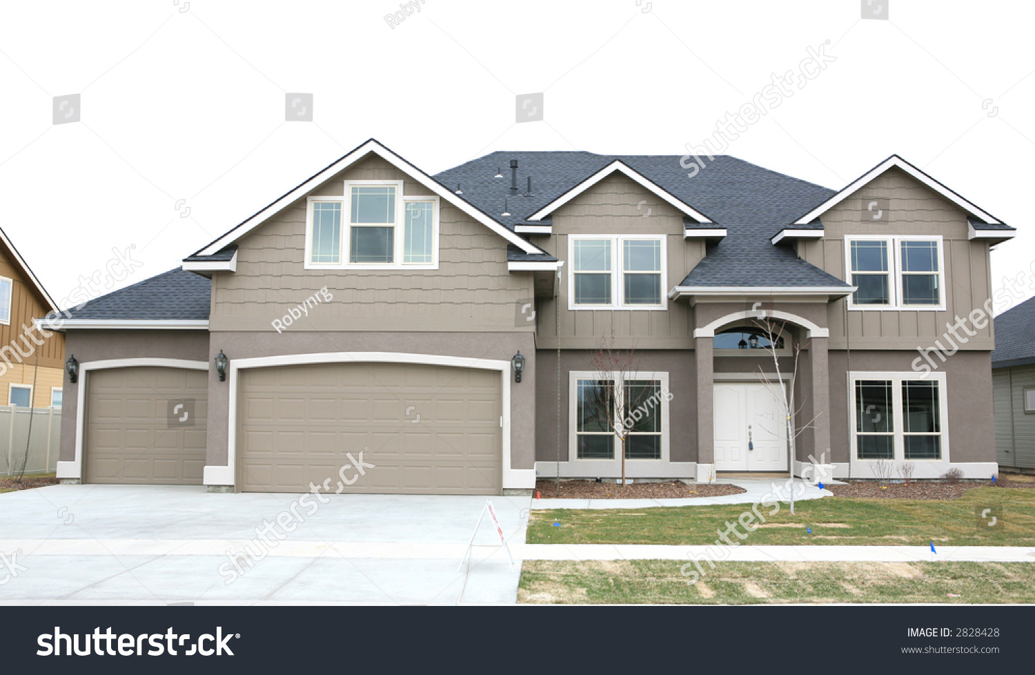 Brown two story house three car stock photo 2828428 for What is two story house