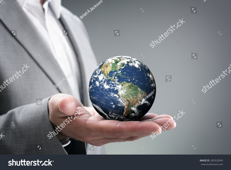 Technology Management Image: Businessman Holding World Palm Hands Concept Stock Photo