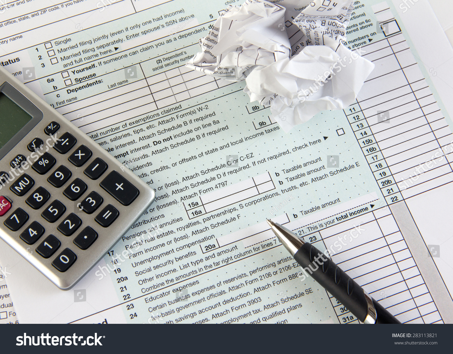Federal income tax form 1040 crumpled stock photo for 1040 tax table calculator