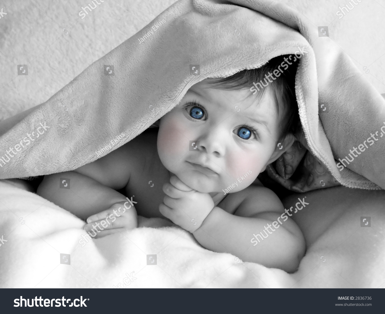 Beautiful baby in black and white with blue eyes and pink cheeks