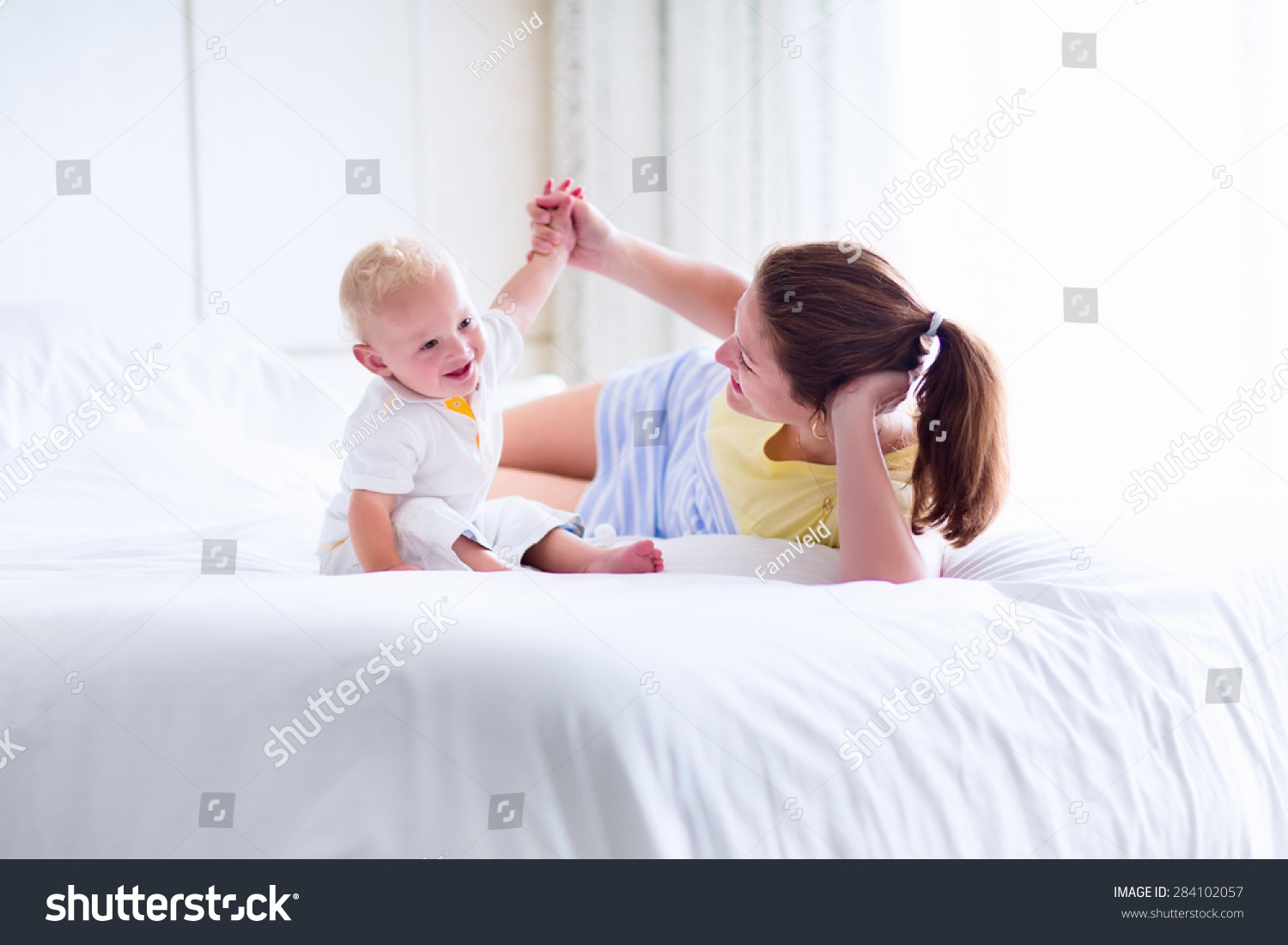 Baby bed next to mom - Mother And Baby In Bed Young Mom Playing With Her Newborn Son Child And
