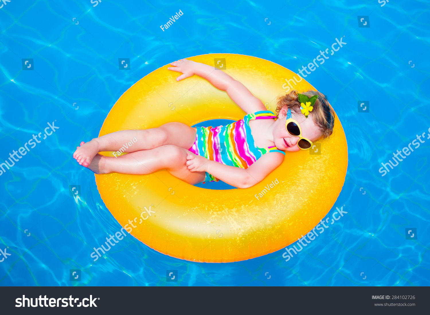 Product details of new inflatable floating swim ring kids children toy - Child In Swimming Pool Little Girl Playing In Water Vacation And Traveling With Kids