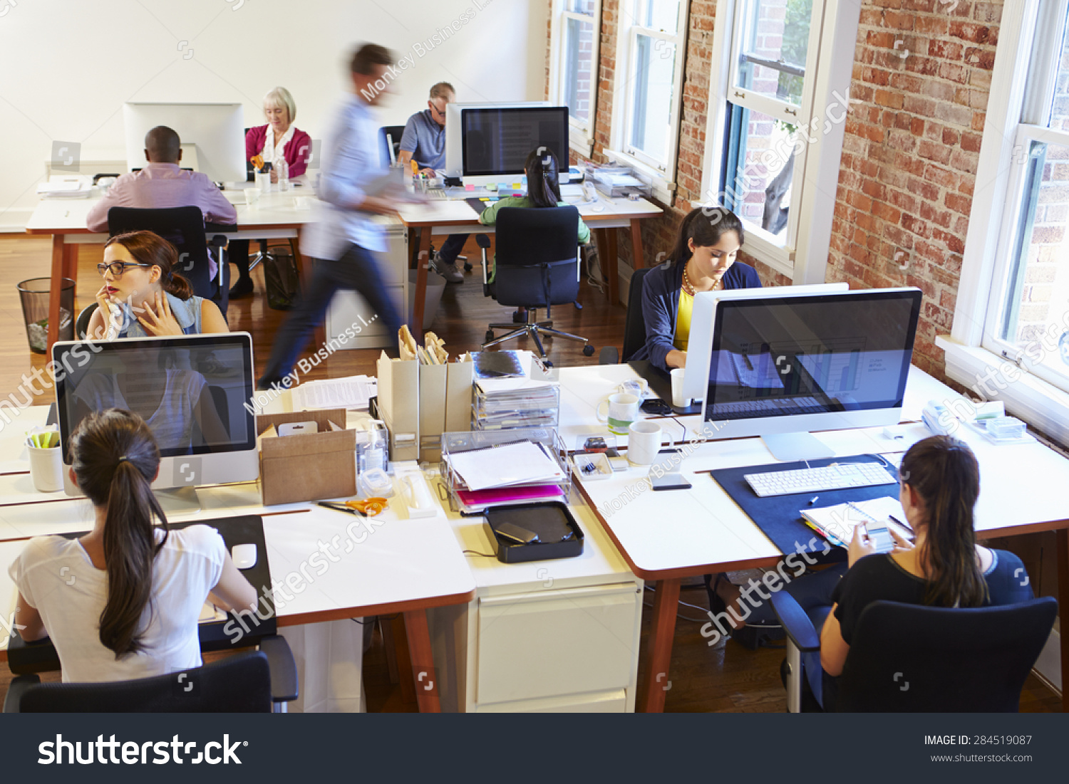 Wide Angle View Of Busy Design Office With Workers At Desks #284519087