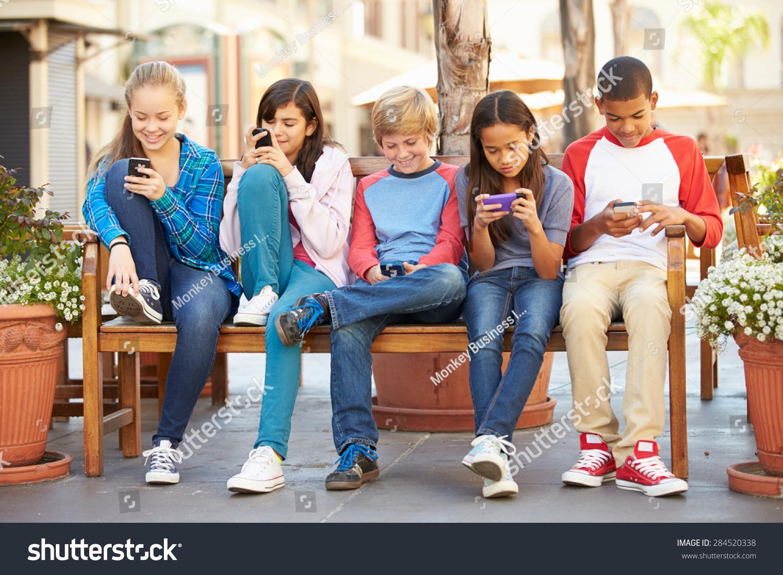 http://image.shutterstock.com/z/stock-photo-group-of-children-sitting-in-mall-using-mobile-phones-284520338.jpg