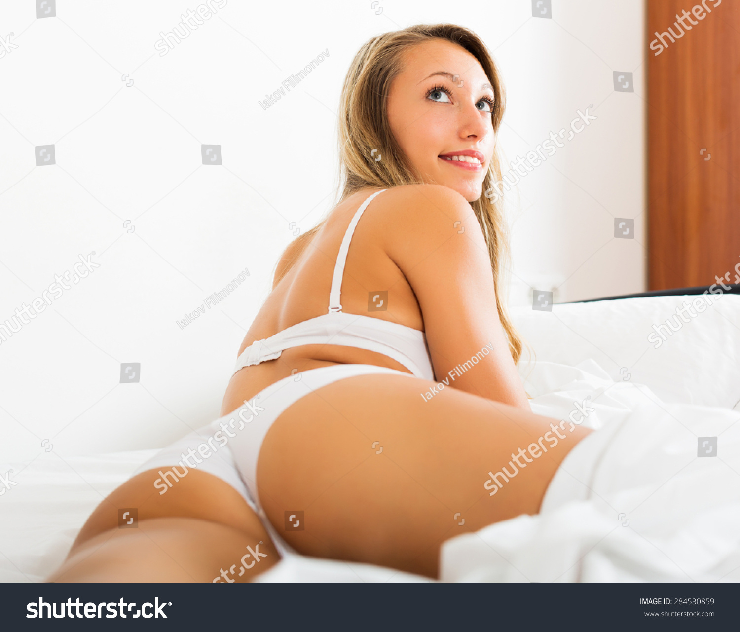 sexy blonde longhaired woman underwear posing stock photo