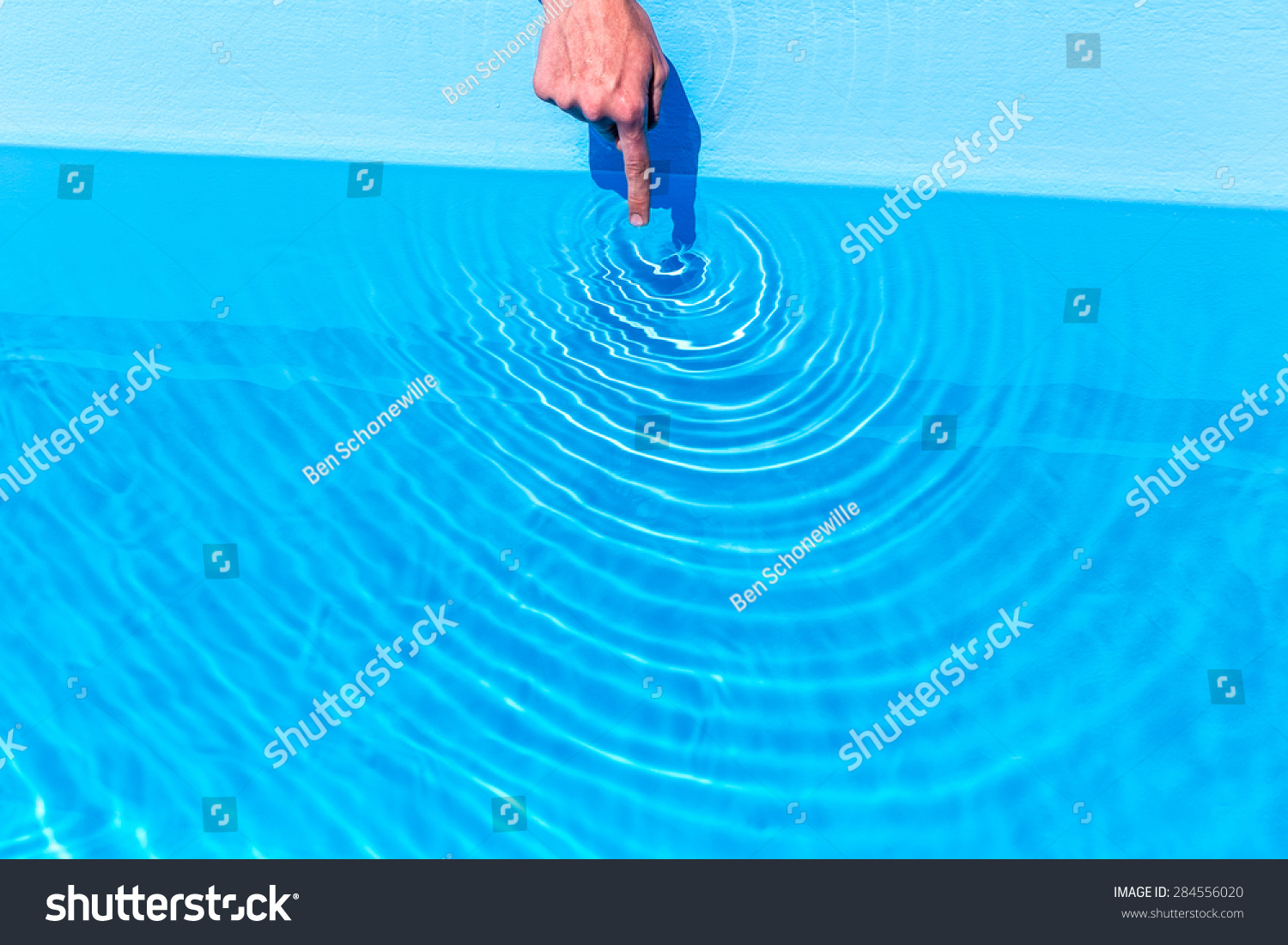Forefinger Making Circular Waves In Water Of Blue Swimming Pool Stock Photo 284556020 Shutterstock