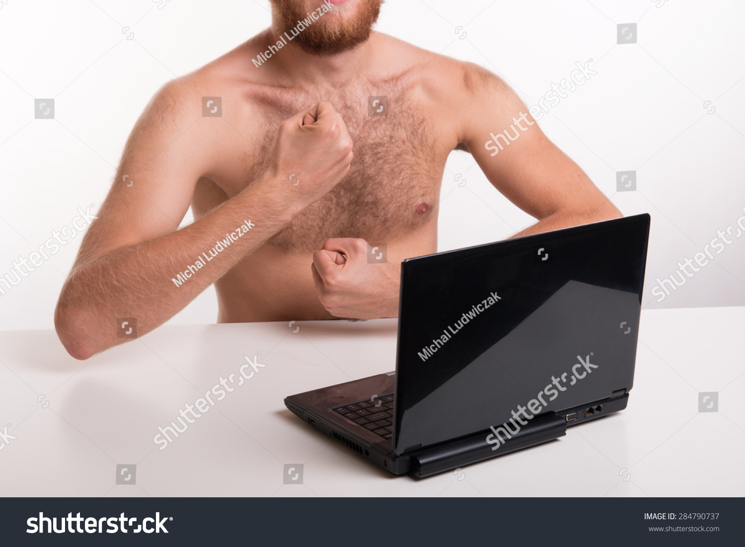 A man showing chest in front of webcam
