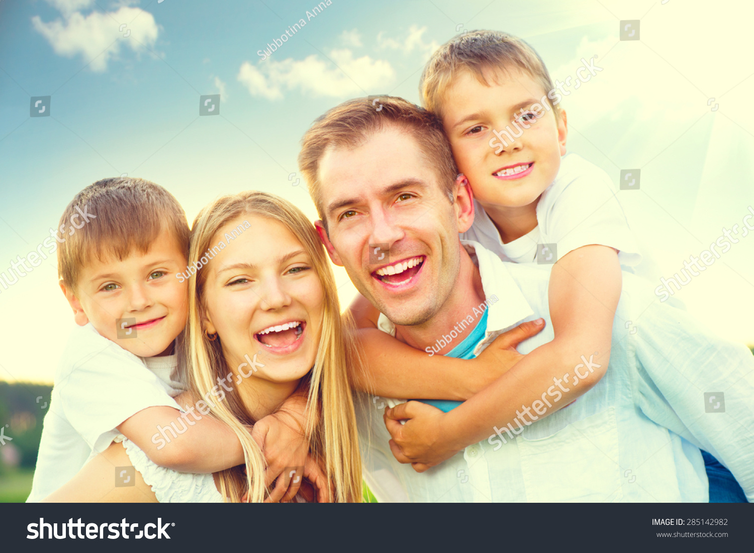 happy joyful young family father mother stock photo 285142982 shutterstock. Black Bedroom Furniture Sets. Home Design Ideas