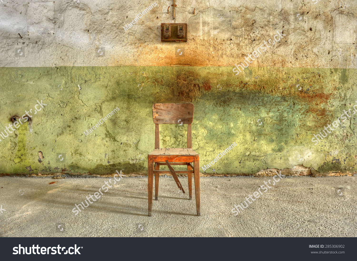 Old Broken Wooden Chair Against A Filthy Wall In An Abandoned Prison Ready