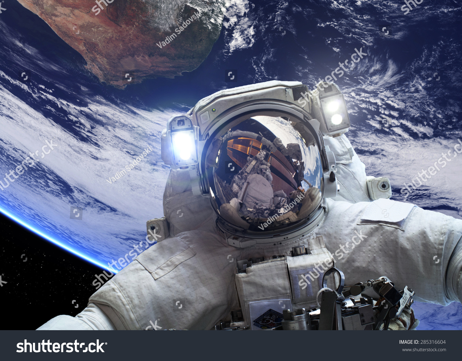 Astronaut outer space against backdrop planet stock photo for Outer space elements