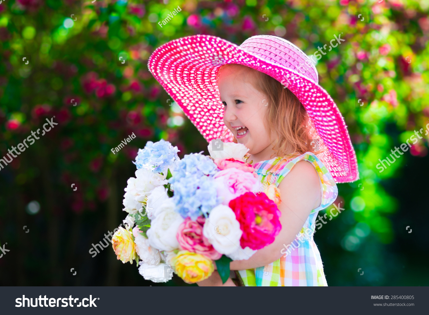 Royalty Free Little Cute Girl With Flowers Child 285400805 Stock