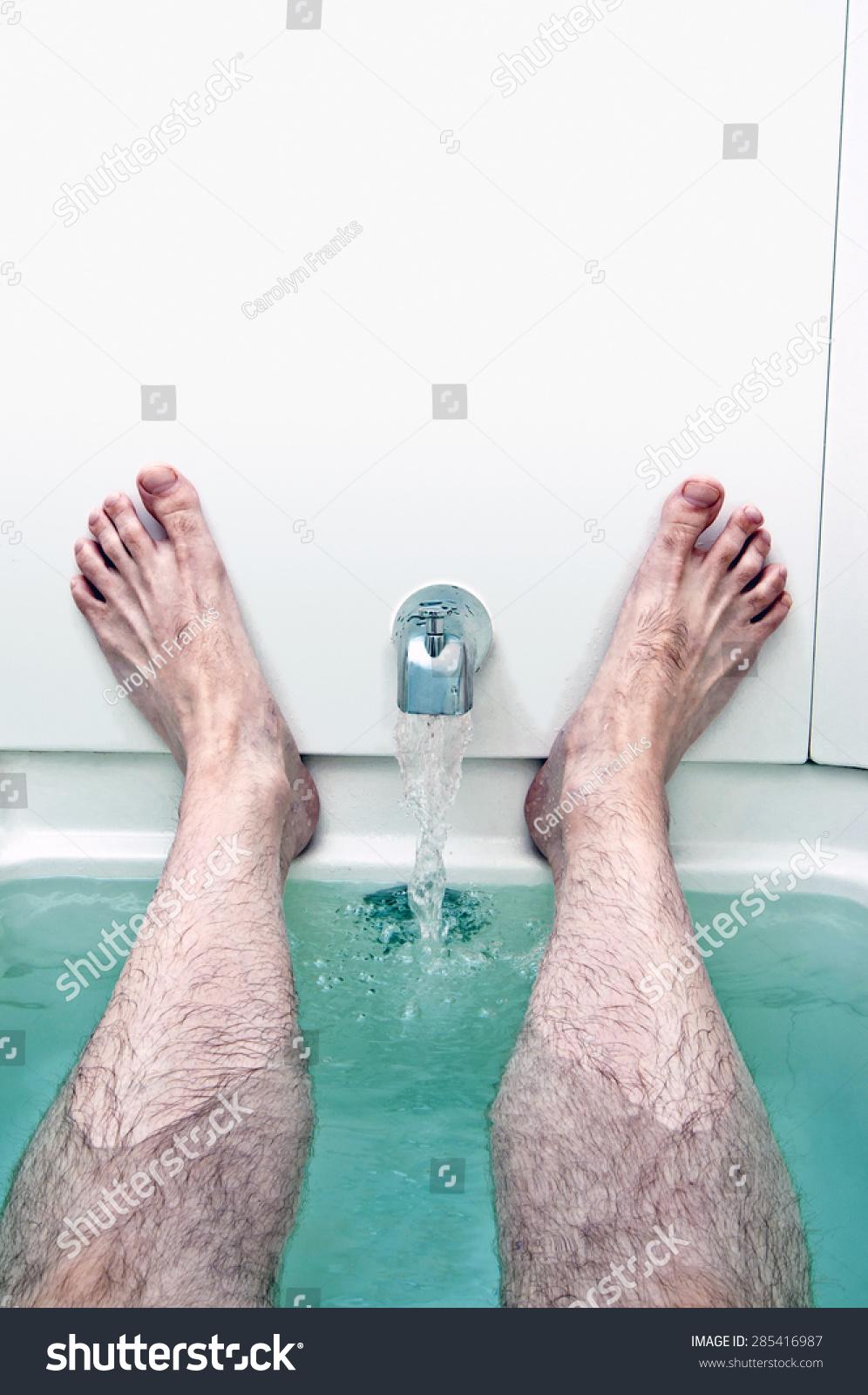 Bathtub Water Running Between Mans Feet Stock Photo (Royalty Free ...