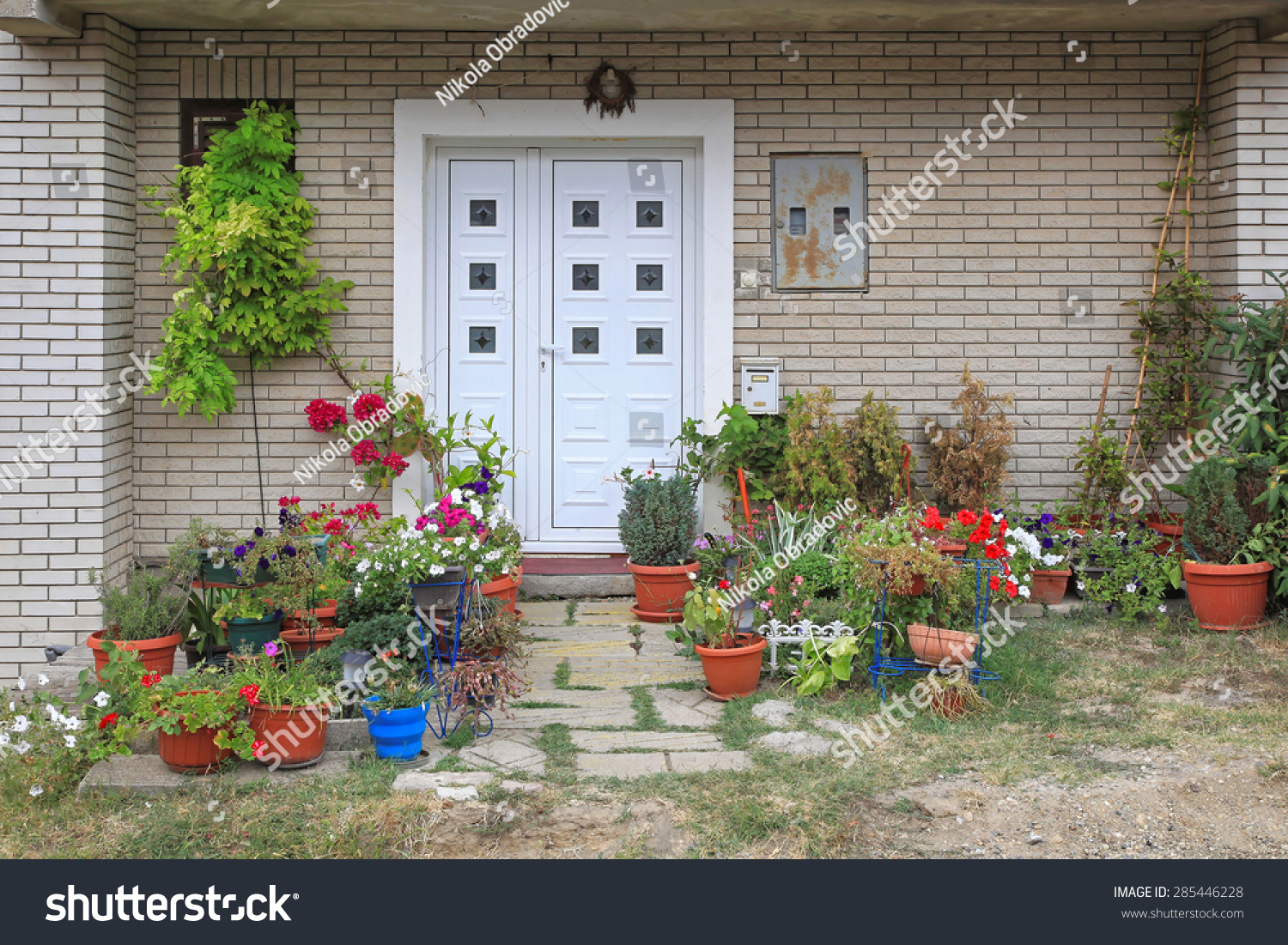 Flowers And Plants In Front Of House Entrance Stock Photo