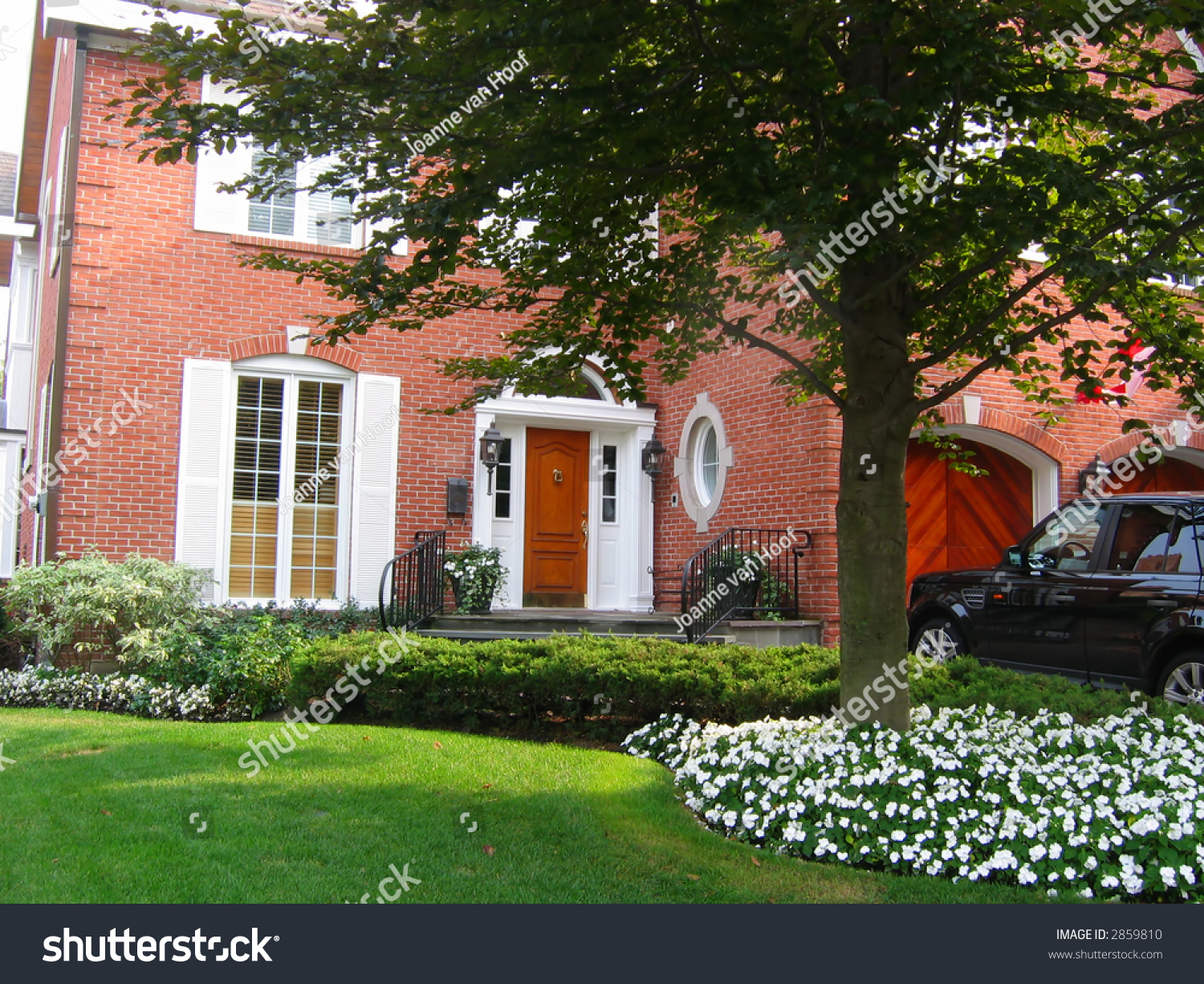 Bright Green House Red Brick House With White Shutters And Bright Green Manicured Lawn