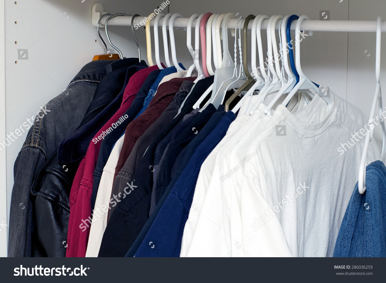 looking inside mans closet armoire full stock photo 286036259 shutterstock. Black Bedroom Furniture Sets. Home Design Ideas
