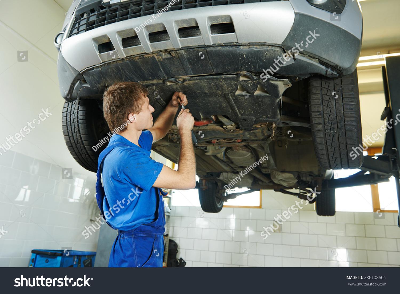 Garage Auto Mechanic Repairman Assembling Bottom Stock Photo