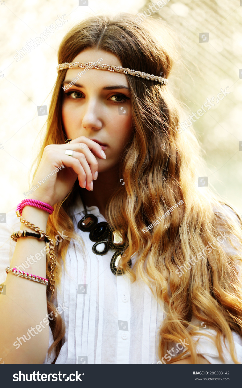 35f4f2e86af Fashion portrait of beautiful hippie young woman wearing boho chic clothes  and summer hat outdoors.