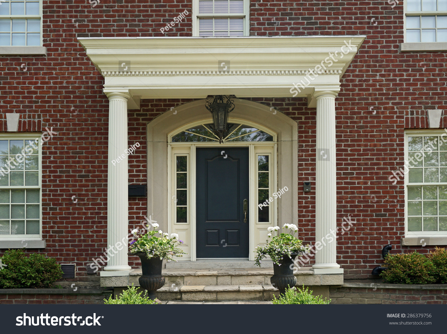 Front door large brick house portico stock photo 286379756 for Large front door