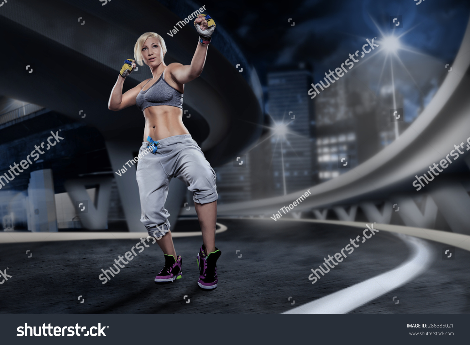 Woman sport dress piloxing exercise on stock photo 286385021 woman in sport dress at piloxing exercise on the night street xflitez Image collections