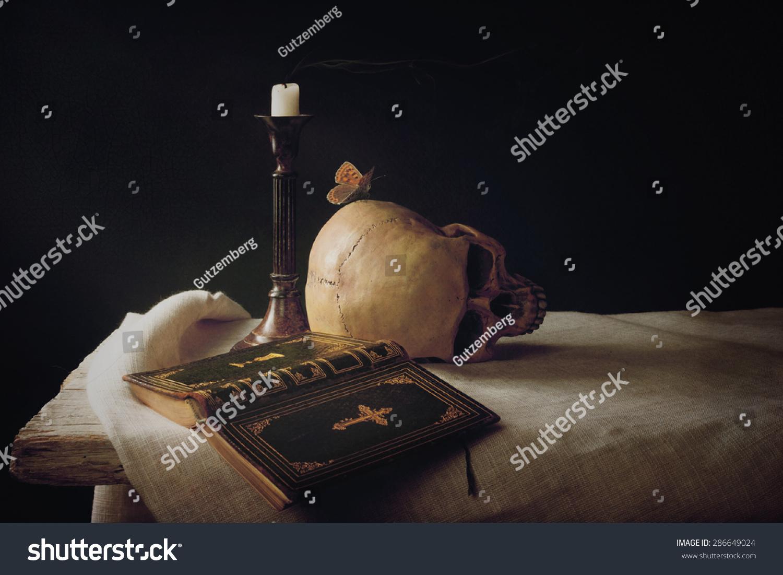 Symbol for resurrection choice image symbol and sign ideas vanitas bible skull candle symbol life stock photo 286649024 vanitas bible skull candle as symbol for buycottarizona