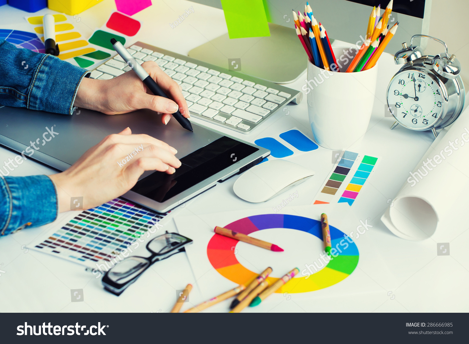 Young handsome graphic designer using graphics stock photo for Job grafiker