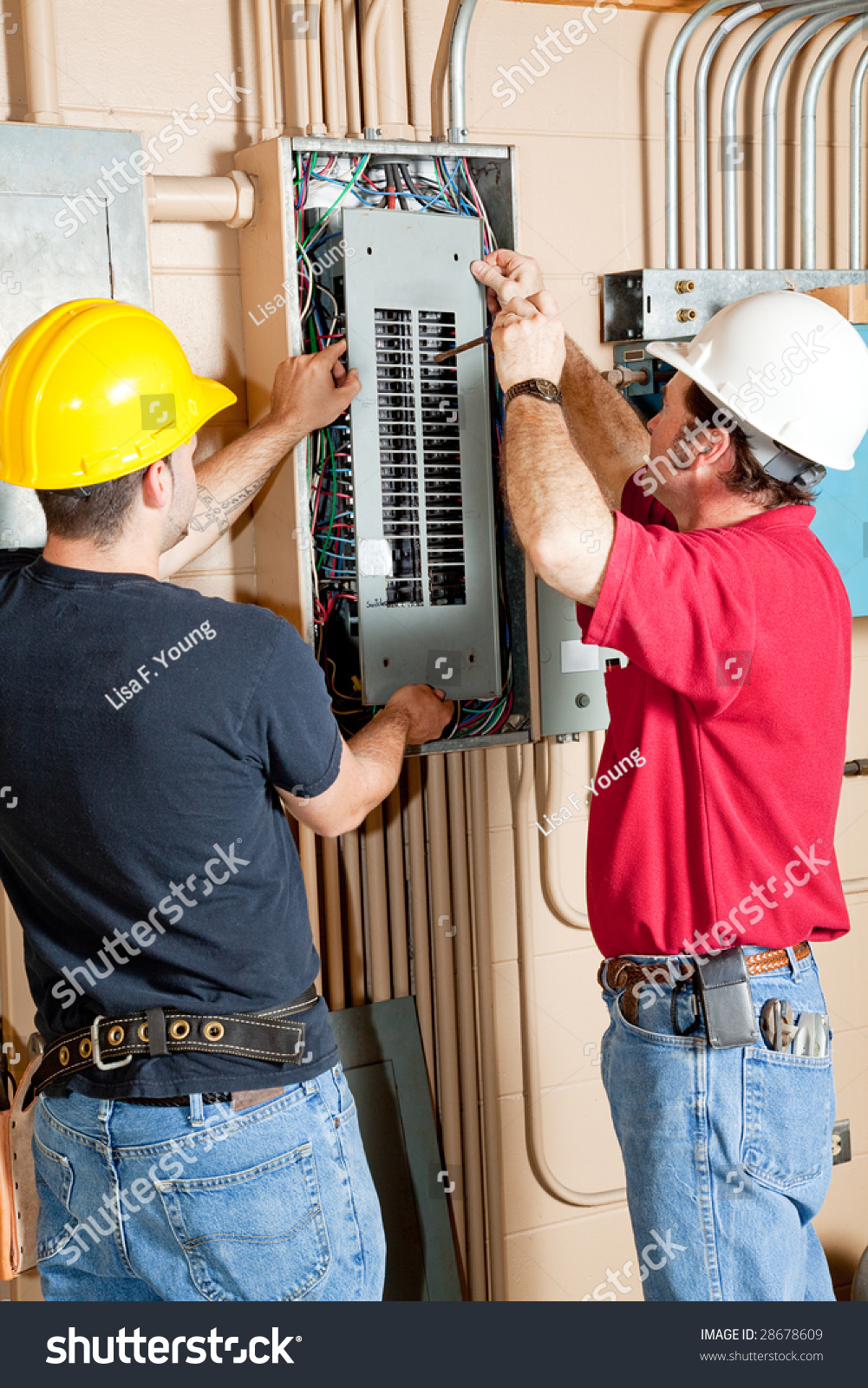 Two Electricians Repairing Electrical Circuit Breaker Stock Photo Wiring And Breakers Electrician An Panel In Industrial Setting
