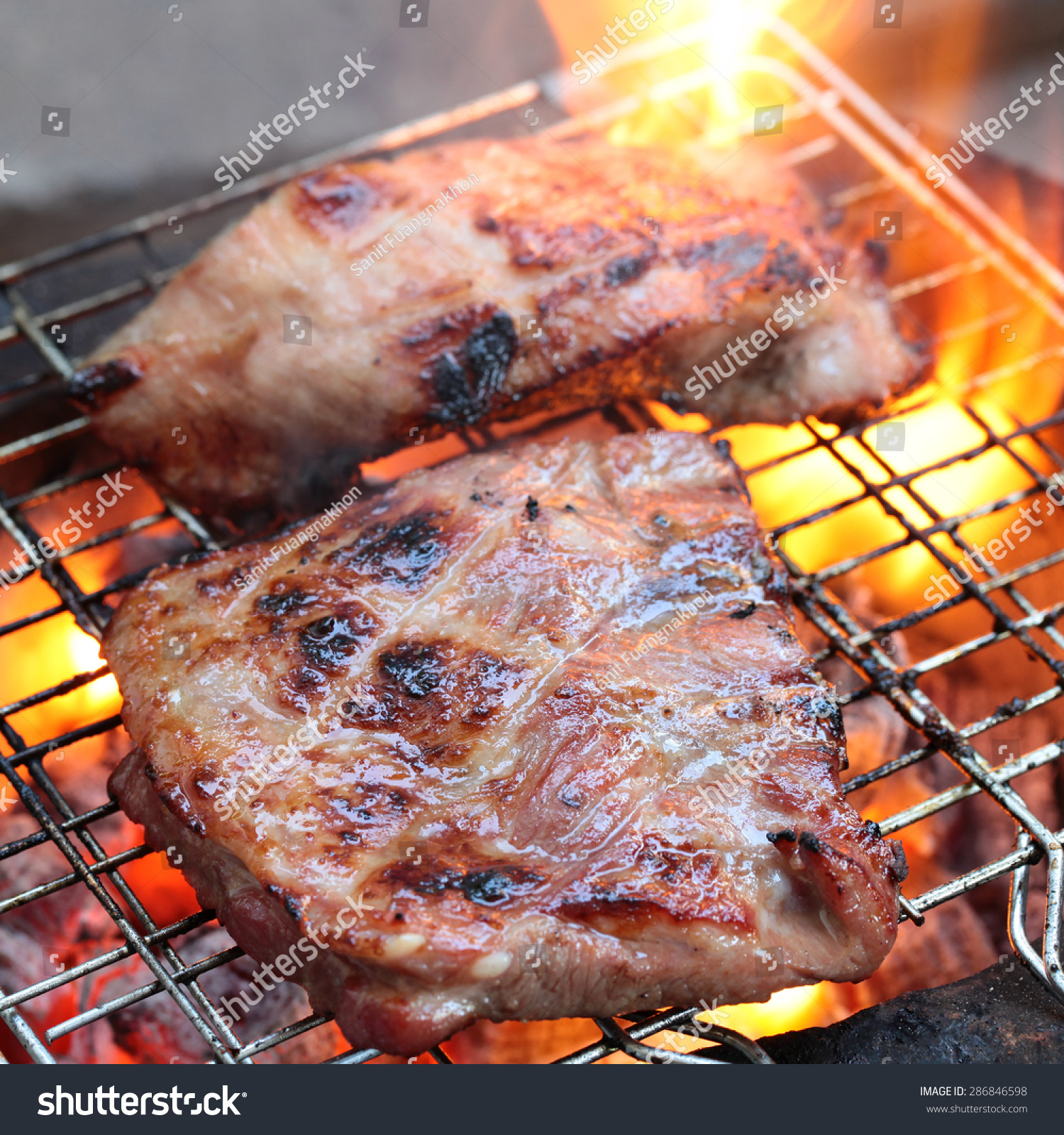 Grilling Sirloin Steak Flame Broiled On Stock Photo ...