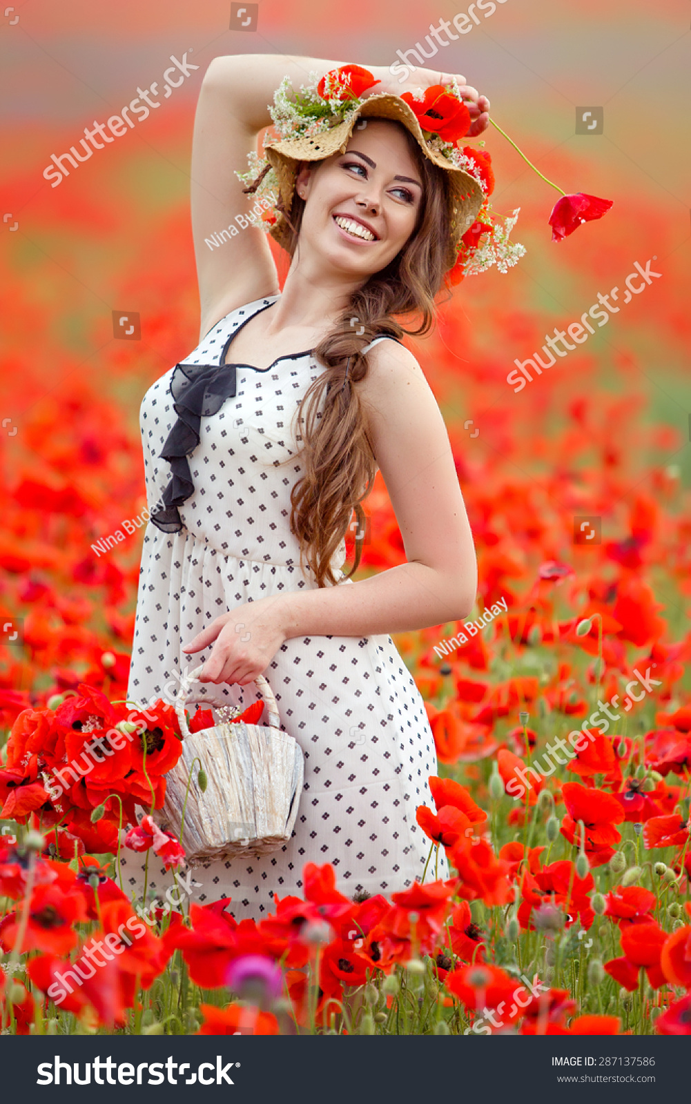 Beautiful woman field flowers stock photo 287137586 shutterstock beautiful woman in a field with flowers dhlflorist Gallery