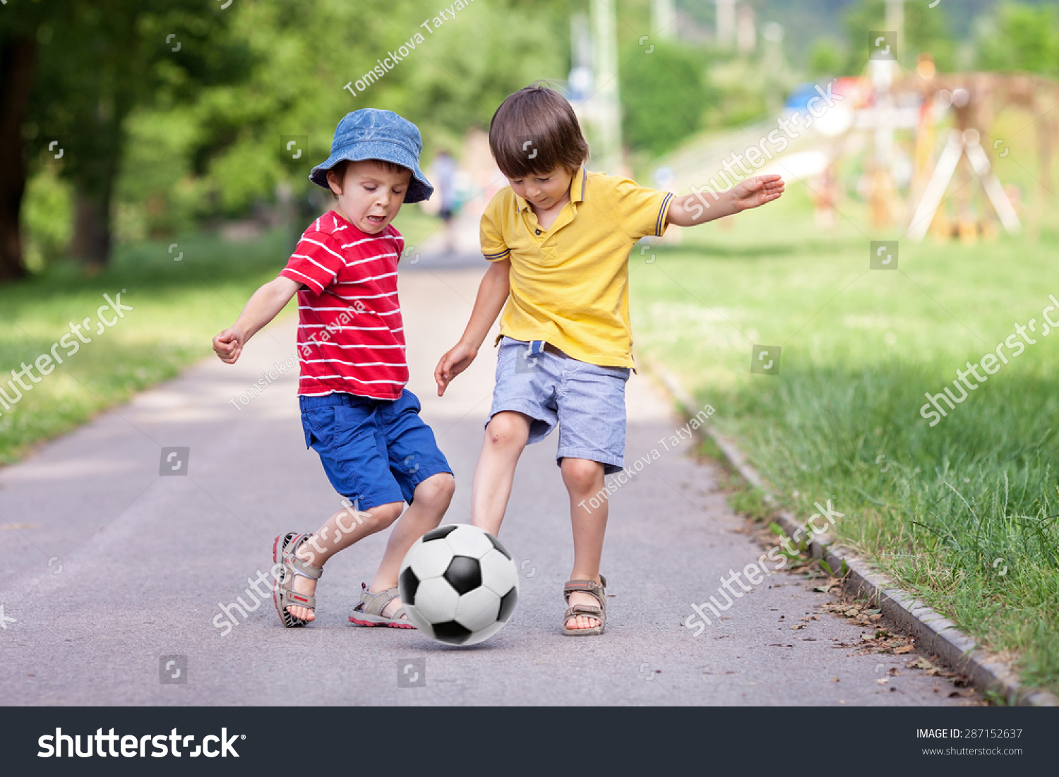 two cute little kids playing football together summertime children playing soccer outdoor - Little Kids Pictures