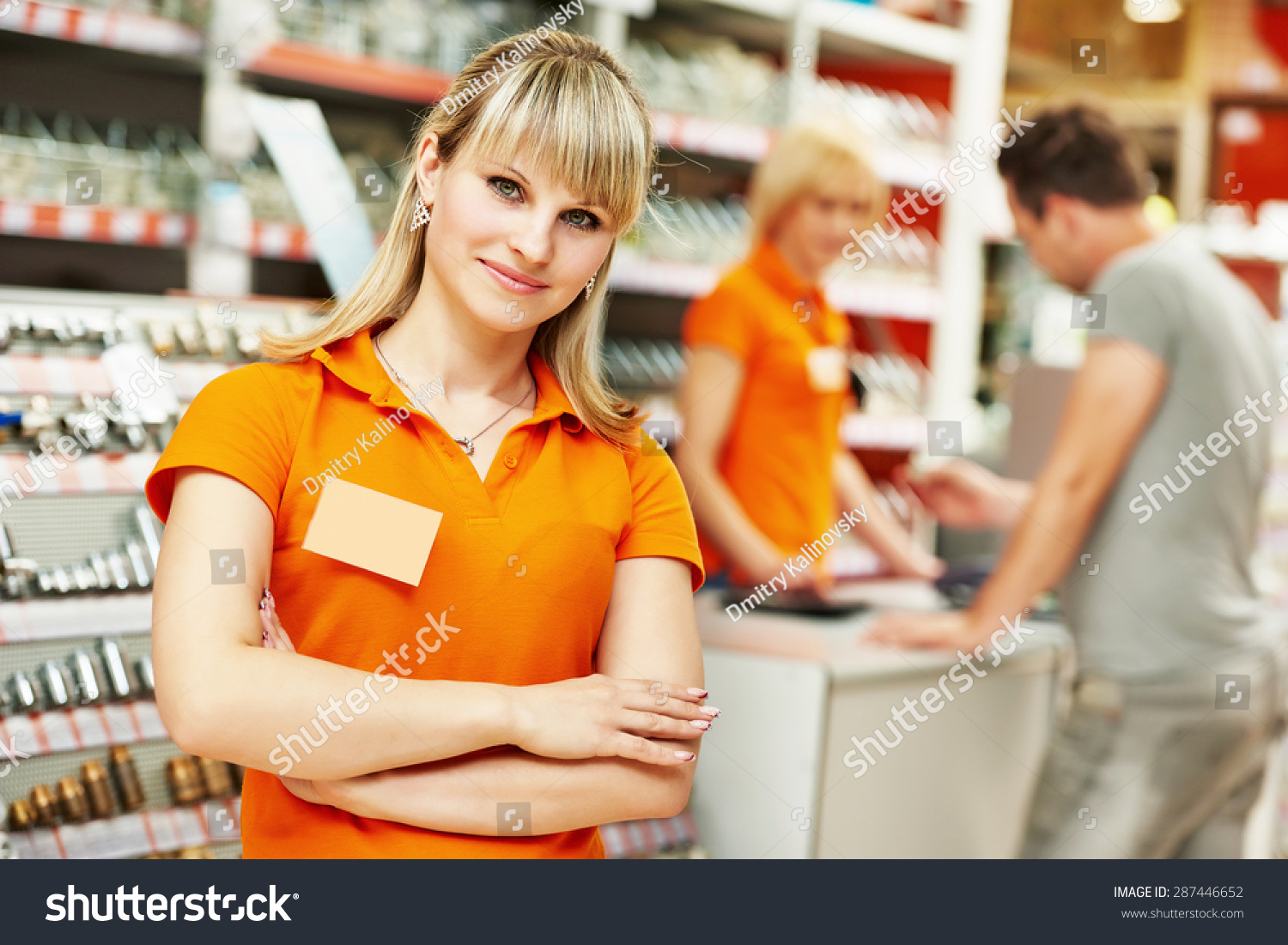 positive female seller shop assistant portrait stock photo positive female seller or shop assistant portrait in hardware supermarket store