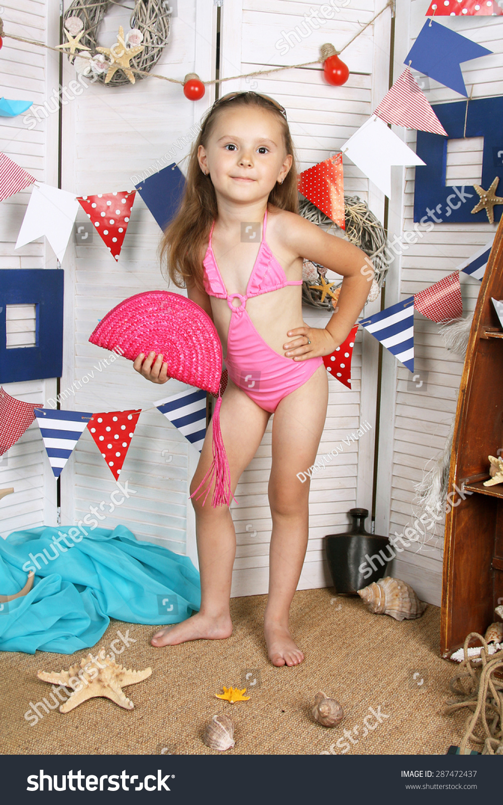 Little girl in bathing suit stock photography image for A beautiful you at vesuvio salon studios